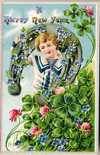 1909 Happy New Year Boy in Horseshoe, Clover, Forget-Me-Nots Emb. Postcard