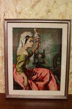 Quadro a mezzopunto raffigurante donna che fila con cornice 64 x 79