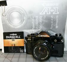 CANON A-1 35mm CAMERA w/ 50mm LENS, MANUAL & NEW BATTERY