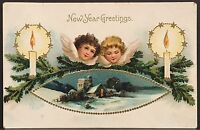 New Year's Postcard ~ Two Cherubs In Sky Look Over Snowy Village ~ Candles