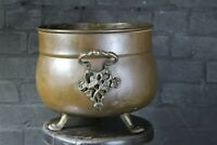 Vintage antique copper cauldron planter on three brass claw feet brass handles