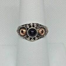 A262 SS Ring w/black onyx type center stone. Size 7