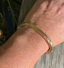Vintage 1980s, Wide 9ct Yellow Gold Oval Hollow Twist Hinged Bangle. 9.82 grams