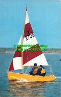 R529098 Heron. Hard chine centreboard gunter rigged dinghy. Salmon. 5573