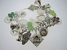 "* .925 STERLING SILVER CHARM BRACELET 6"" WITH 23 CHARMS 70 GRAMS"