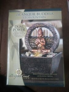 Tranquil Buddha LED Fountain w/ Flowing Water Dual Power Natural River Rocks NIB