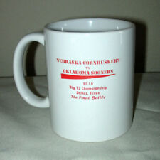2010 BIG 12 CHAMP MUG - NEBRASKA CORNHUSKERS VS. OKLAHOMA SOONERS - FINAL BATTLE