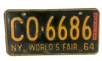 1964 New York Worlds Fair License Plate 64 w/ 65 Reg CO-6686 - VINTAGE!