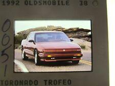 OLDSMOBILE TORONADO TROFEO PRESS SLIDE - 1992