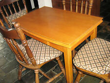 EXTENDABLE dining table and 4 colonial chairs Great for a small unit