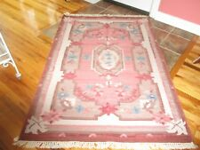 Floral 4 by 6 area rug. Dark pink & beige with blue flowers.