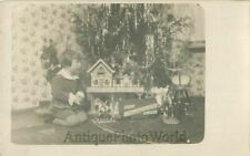 Girl by Christmas tree w toy doll house bicycle rocking horse antique rppc photo
