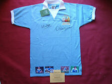MANCHESTER CITY MICK DOYLE & DENNIS TUEART SIGNED 1976 LEAGUE CUP SHIRT- PROOF
