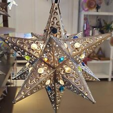 Mexican Tin Star with Marbles Hand Punched Bronze finish.
