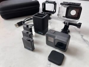 Barely used GOPRO Hero 5 Black, Extra Charger, 3 x Batteries PLUS cases & mounts