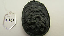 A BEAUTIFUL CARVED DRAGON STONE PENDANT ON A WAXED CORD NECKLACE.  (170)