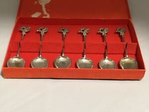 Boxed set of six silver plated spoons with lyrebird? peacock? decoration