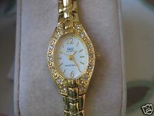 New Q&Q by Citizen Gold Tone Lady Watch w/Diamond Bezel & White Dial