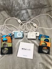 (2) Apple iPod shuffle 2nd Generation Light Blue and Silver w/ Bases Bundle