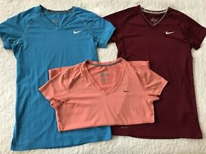 Lot of 3 Nike shirts Women Large 2 NIKE Pro blue maroon fitted & 1 peach dri fit