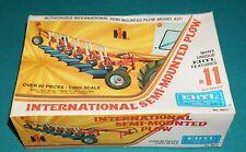 International Semi Mounted Plow Ertl 1/25 Complete & Unstarted.