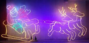 Waving Santa in Sleigh with Reindeer