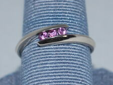 10k White Gold ring with pink sapphires and a beautiful dsign