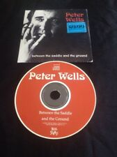 PETER PETE WELLS CD BETWEEN THE SADDLE AND THE GROUND ROSE TATTOO AUSTRALIA