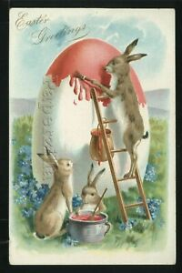 EMBOSSED CHROMOLITH c.1905 BUNNY RABBITS PAINTING EASTER EGG from LADDER Tuck