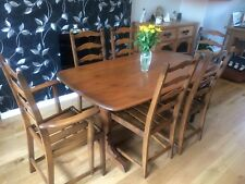 ERCOL Dining Table and Six Ladder back Colonial Chairs ....incudes 2 Carvers