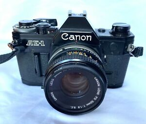 Canon AE1 SLR Camera with 50mm 1.8 and FD 200mm 1:4 lenses plus Hanimex Flash.