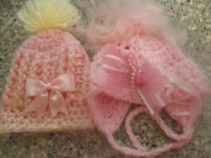 2 baby girls hand knitted hats age approx 0 to 4 months VGC