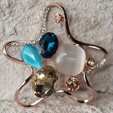 Neu BROSCHE Seestern mit GLAS STRASSSTEINE Farbe rosegold/blau/rosa