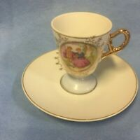 Antique footed small victorian courting couple Tea cup and saucer set