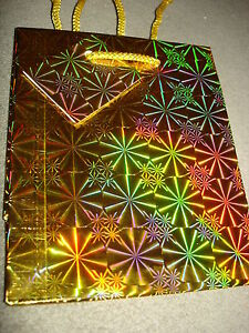"""HOLIDAY MINI GIFT BAGS  LOT OF 10  APPROX. SIZE 4 1/2"""" X 5 1/2"""" SHINNY GOLD"""