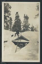 CA Big Bear Lake RPPC 20's MAN SHOVELING SNOW from ROOF of CABIN Buried in Snow