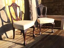 A pair of Antique Edwardian shield  back chairs with claw feet.
