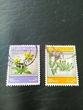 2 USED STAMPS OF OMAN 1983 FLOWERS 10 & 20 BAISA SG 260 & 261.