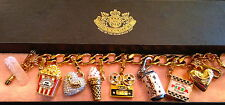 "JUICY COUTURE ""MOVIE"" THEME CHARM BRACELET WITH 6 RETIRED CHARMS"