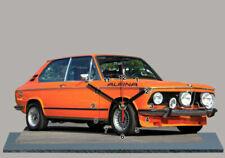 Voitures miniatures oranges BMW