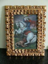Painting of solder on horse attacking man, in ornate frame