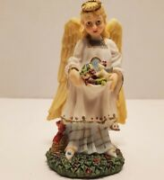 Angel Holding Toys Figurine