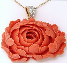 Pink carved rose coral pendant with 18k yellow gold diamond enhancer