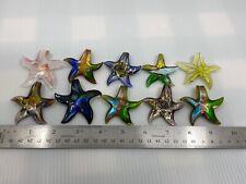 10 Pretty glass starfish pendants.