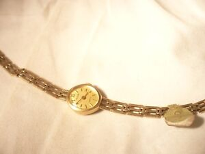 ladies Accurist Gold case and braclet watch