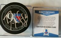 BECKETT COA DEREK STEPAN SIGNED OFFICIAL GAME PUCK NEW YORK RANGERS 90yrs NHL