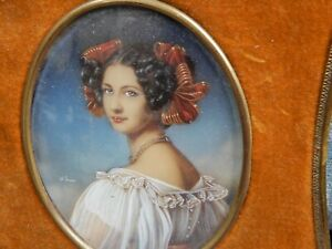 PORTRAIT MINIATURE OF A BEAUTIFUL LADY IN A VELVET FRAME SIGNED