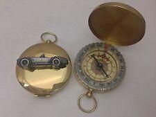 Shelby Cobra ref239 Pewter Effect car emblem on a Golden Compass