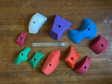 Lot of 10 used climbing holds. Pinches of various brand and color
