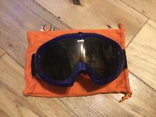 Spy goggles. dark blue frame, black and white head strap.